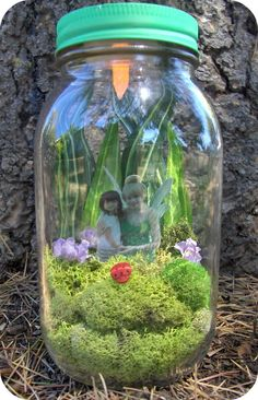 fairy jars. Cut out picture of child and hot glue candle light to inside of lid. Cute party favors.