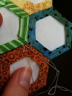 stitching hexagons together, ladder stitch, not whip stitch, nice example - *love* this!  I thought I was the only one who did this!