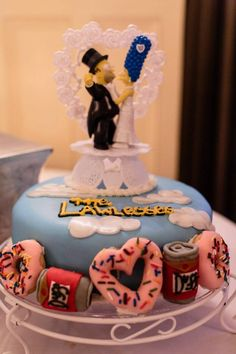 our wedding. surprise groom's cake! homer and marge. the simpson's! photo by Tracey Buyce Photography! @Wendy Dlugolecki-De La Cruz