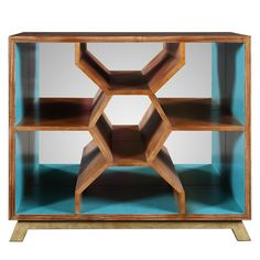 With its mirrored geometric design and Caribbean blue interior finish, this stylish bookcase lends a distinctive touch to your study or den. ...