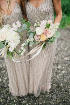 bridesmaids wearing taupe dresses with beads holding loose floral bouquets