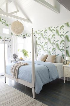 Leaf wall paper + light blue bedding + navy stained floors.  The Glamorous Housewife: The Glamorous Housewife In Country Living Magazine