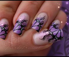 Says butterfly nail art but for some reason I think more dragon or like purple fire.