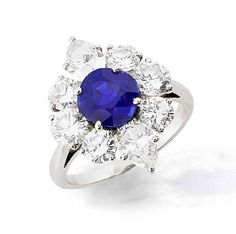 A sapphire and diamond cluster ring, by Cartier
