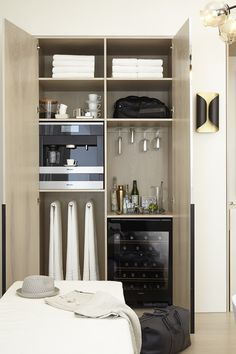 Designer Geneviève Ghaleb was inspired by the present day Contemporary Movement in Miami to create this #DXVDesignPanel bathroom for a busy gentleman in need of intentional daily luxury, achieved in part by a built-in closet space complete with Miele coffeemaker and wine fridge.