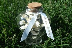 """Wedding gift I made for a close friend.  Cut strips of their invitation and twirl them around a pencil, then put in a pretty jar or ornament.  I tied a """"And they lived happily ever after"""" script ribbon around the top.  A great idea for baby shower gifts as well."""