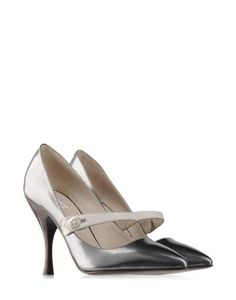 @thecornerstore  modern take on the mary jane by Marc Jacob's with a pewter shoe white strap and button closure