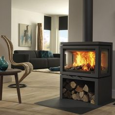 DRU – Vidar Triple is a freestanding wood stove with windows on 3 sides – Freestanding fireplace wood burning Freestanding Fireplace, Home Fireplace, Fireplace Ideas, Pellet Fireplace, 3 Sided Fireplace, Wood Burner Fireplace, Fireplace Windows, Home Accessories, New Homes