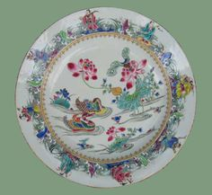 Pair of exceptional Chinese famille rose plates, Yongzheng (1723-1735), decorated with pair of Mandarin ducks on a pond with lotus flowers, with a border of waves with the eight immortals