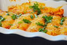 Rotisserie Chicken Enchiladas - The Anchored Kitchen Filled with chicken, peppers and black beans, these Rotisserie Chicken Enchiladas are full of delicous Mexican flavors and easy to prepare on a weeknight. Rotisserie Chicken Uses, Rotisserie Chicken Enchiladas, Cooked Chicken, Kitchen Recipes, Cooking Recipes, Meal Recipes, Dinner Party Menu, Dinner Ideas, Enchilada Recipes