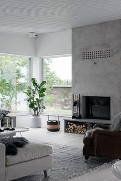 Living Room Simple Concrete Fireplace Design A fireplace is often a structure crafted from brick, st Home Fireplace, Fireplace Design, Contemporary Fireplace Designs, Living Room With Fireplace, Concrete Fireplace, Scandinavian Fireplace, Minimalist Interior, House Interior, Fireplace Hearth