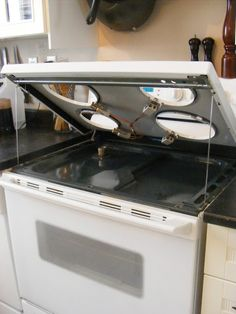 OMG! I did not know that most electric stoves lifted up like a car hood!! This is gonna make cleaning soooo much easier!!