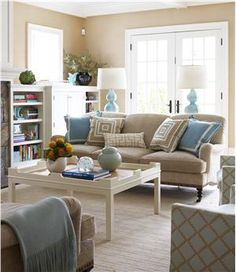 Love!  Contemporary (Modern, Retro) Living Room by Lauren Muse Light blue and tan living room