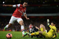 Theo Walcott of Arsenal FC against Tottenham Hotspur FC