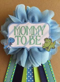 Baby Shower Boy Dinosaurs Baby Shower Pin Mommy to be pin Flower Ribbon Pin Corsage Glitter Rhinestone Mommy Mom New Mom Its a boy Dinosaurs Baby Boy Shower Mommy-to-be Flower Ribbon by afalasca Baby Shower Pin, Baby Shower Flowers, Boy Baby Shower Themes, Baby Shower Parties, Baby Showers, Mommy To Be Pins, Flowers For Mom, Baby Dinosaurs, Dinosaur Birthday Party