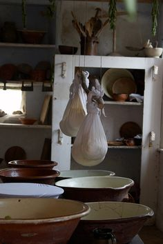 "https://flic.kr/p/gAUxs | Blessed are the Cheesemakers, Kentwell 1578 | Cheeses hang over bowls to catch the dripping whey at <a href=""http://www.kentwell.co.uk"">Kentwell Hall</a>.  The  <a href=""http://www.kentwell.co.uk/Re-Creations/index.html"">Great Annual Tudor Re-Creation""</a> features 300+ dedicated re-enactors in costume and in character around the Elizabethan house, farm and grounds. This year was 1578."