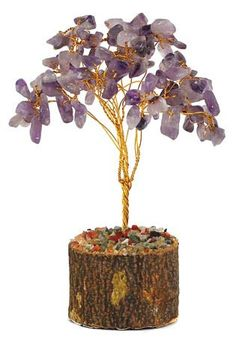 Amethyst Gemstone Tree  Beautiful and powerful both symbolically and energetically, the amethyst gemstone tree features dozens of amethyst chips as the leaves of a small wire tree. Sprouting from a small, sawed piece of wood, a wire tree rises up to host purple amethyst stones. Amethyst is said to be a wonderful stone of the mind, helping to enhance psychic powers, offer wisdom, and otherwise achieve such mental qualities.  $7.95