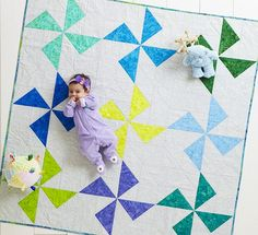 Looking for a quick shower gift? Larger-than-life Pinwheel blocks  ensure this baby quilt comes together quickly.