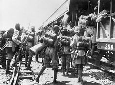 THE CAMPAIGN IN GERMAN EAST AFRICA DURING THE FIRST WORLD WAR. Following mobilisation, 1st Battalion, The Nigeria Regiment entrain at Kaduna for Lagos, after which it would proceed to Duala in the German Cameroons. This battalion was armed with the long Lee Enfield rifle and short bayonet. Sleeping blankets and rain capes are carried rolled on the back. The soldier who is not wearing a fez is carrying his sleeping mat under his left arm