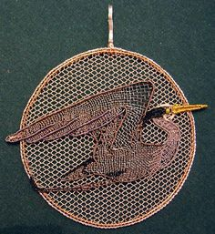 """""""Flying Heron"""" Pendant by Susan Lambiris. Exquisite bobbin lace pendant made with wire."""