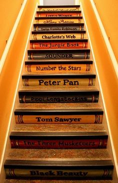 On the stairs to the attic/kid's play area.  Use book titles read to them at bedtime and allow them to pick new titles as they discover new favorites!