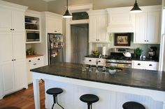 small white kitchen with island sink