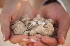 A great photograph of the wedding rings for a beach wedding ceremony.