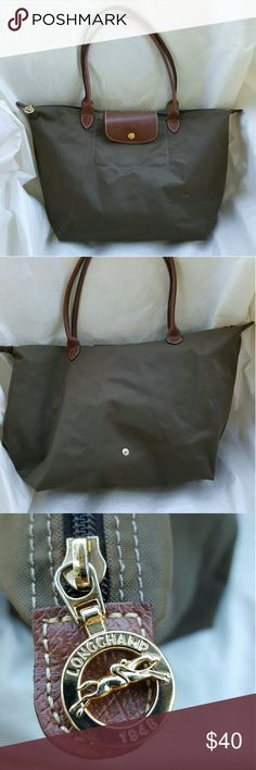 Longchamp Le Pliage Taupe Large Tote Shopper There is a small hole in the 4 corner bottom. Please see pictures for reference.   Pretty large Shopper and roomy. Trim with brown leather. Longchamp Bags Totes