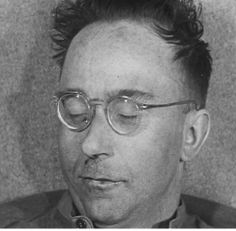 Heinrich Himmler photographed only moments after he committed suicide in the hands of the British. His trademark mustache is gone -- he shaved it in an effort to change his facial characteristics and pose as a farm hand. A British doctor, who examined him right after his arrest, failed to discover the cyanide capsule in his mouth thus allowing one of most barbaric figures of all time to escape just punishment.