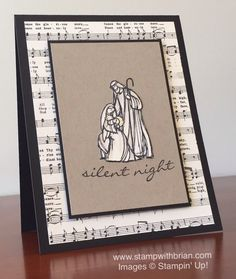 handmade Christmas card: All Ye Faithful ... strong basic layout by Brian King .... black and white with kraft ... sheet music as wide background mat ... Holy Family stamped on vanilla, colored with shading, cut out and placed as focal point on main panel in kraft ... luv the simplicity and non-traditional colors here  ... Stampin' Up!
