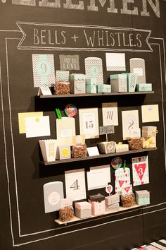 Could create a board with mini shelves on chalkboard paint board.