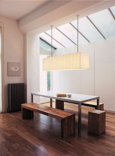 Kitchen - slanted windows in kitchen alcove, also like lighting above table.