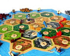 Some of my custom pieces for Settlers of Catan.