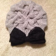 Francesca's knit hat Gray knit hat with black lace bow detail. Worn only once! Francesca's Collections Accessories Hats