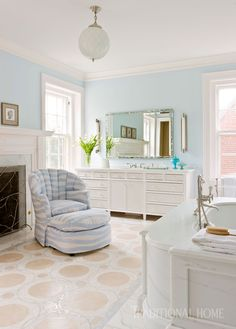 """The floor by Renaissance Tile and Bath is laid in a custom mosaic design by homeowner/designer David, who re-covered the vintage chair and ottoman in periwinkle """"Tides"""" from Perennials. - Photo: Gordon Beall / Design: David Herchik"""