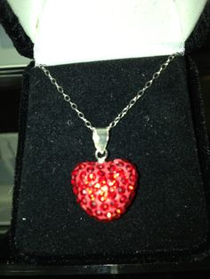 Sterling Silver and red Swarvoski Crystal heart necklace at The Golden Butterfly Jewelers.