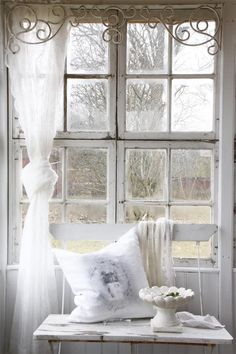 just white...love this old window and how this is decorated...looks dreamy