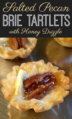 Salted Pecan Brie Tartlets with Honey Drizzle A fun and easy appetizer recipe made with mini phyllo cups filled with creamy brie, toasty pecans and sea salt drizzled with honey. Brie Appetizer, Easy Appetizer Recipes, Finger Food Appetizers, Yummy Appetizers, Appetizers For Party, Dessert Recipes, Phyllo Appetizers, Finger Foods, Simple Appetizers