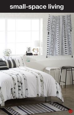 Give your bedroom a dramatic, modern update with black and white decor in a variety of coordinating patterns. Starting with the bed, bring an unexpected twist to a monochromatic look with a comforter inspired by nature, like this birch-print duvet. Add decorative pillows and curtains in simple geometric patterns for contrast, and a small rug at the foot of the bed to tie the room together and add warmth. The key to this style is simplicity. Keep decor to a minimum for a clean, bright vibe.
