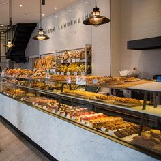These are the best boulangeries in Paris, France, and what to eat when you visit. Do not read on an empty stomach! Good Bakery, Best Bakery, Bakery Display Case, Bakery Interior, Paris Brest, Chocolate Roll, Fruit Tart, Bread And Pastries, Cafe Design