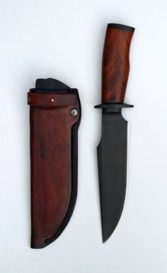 I love the darkness along with aesthetic lines of the knife and sheath.