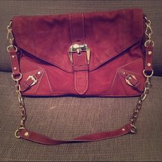 Suede Burgundy Rebecca Minkoff Shoulder Bag Purchased this Rebecca Minkoff Bag at a sample sale last year. I only used it a few times. Will come with original designer dust bag. Three pockets on the inside for phone and personal items and one magnetic closing pocket on the outside. When worn on the shoulder purse falls right below the rib cage. Rebecca Minkoff Bags Shoulder Bags