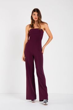 This effortlessly chic jumpsuit features a strapless neckline, flared leg, and princess seams along front... Plum Color, Crepe Fabric, Princess Seam, Jumpsuit, Neckline, Legs, Chic, Model, How To Wear