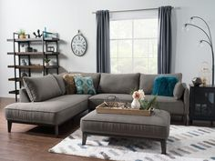 Make a stylish impact on your living space with this Gena two-piece, left-facing sectional. Swathed in soft, linen-look fabric, this grey upholstery offers elegance and charm in one package. You'll have no problem offering friends a seat on the sectional's high-density cushions, which are wrapped in fibre batting for an extra touch of comfort. Resting on a brown-hued solid wood base, this sofa sectional gives your home a sophisticated feel and a cozy resting place all in one.