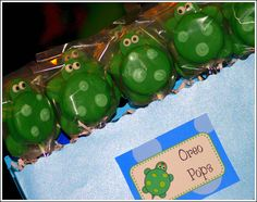 Under the Sea - Oreo pops were a great no-bake treat for the party! I made them by arranging four green candy wafers in a square pattern. I then placed a chocolate dipped Oreo on top to dry.  Once it was part way set, I  pressed another candy wafer into the Oreo for the head.  Wait for the whole thing to cool before adding google eyes and some light green spots using light green melted candy.