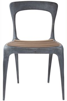 Occasional chair -John Reeves Design Cast Aluminum Chair, $595, available at ABC Home.