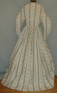 """1860's cotton brown on white maternity dress by pseitas, via Flickr. 1860s cotton print maternity dress. Fabric has a brown printed pattern on white background that has tiny brown dots. Neck, armscyes and waist are piped. Bodice lined with cotton and has front button closure. Skirt unlined. Bust: 38""""; Waist: 34""""; Skirt length: 42"""". [Why maternity? Is this a dress remade into a wrapper? No construction details provided.]"""