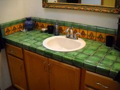 Tile design ideas for countertops, floors, and showers.  Pictures and design tips too.