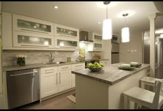Horizontal cabinets are a great use of space in a basement apartment kitchen, they make the ceiling feel taller. Great design from Income Property on HGTV. Basement House, Basement Kitchen, Basement Apartment, Apartment Kitchen, Kitchen Decor, Basement Flat, Kitchen Ideas, Rental Kitchen, Kitchen Designs