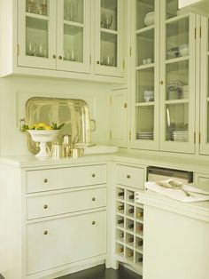 Don't like all the elements but many things about this cabinet style would work in an old kitchen.